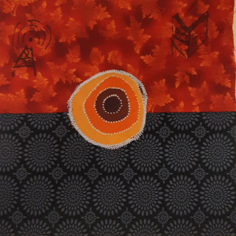 Red upper half with radio tower and book, black patterned lower half with concentric circles or yellow, orange, red appliqued