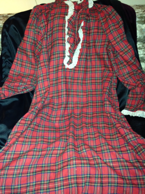 Red plaid nightgown with white piping down the front.