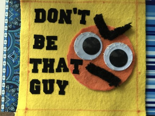 quilt square with text saying don't be that guy