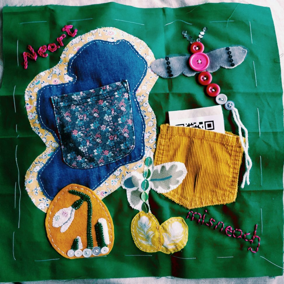 Quilt square with applique Ireland, snowdrop, mayfly and pockets.